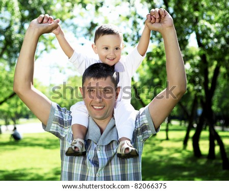 Father with his baby boy outside in the park - stock photo