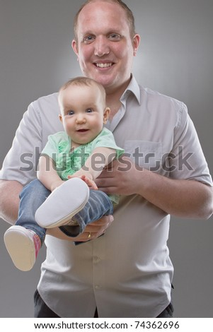 Father with his baby girl. Very cute little toddler with cute shoes. - stock photo