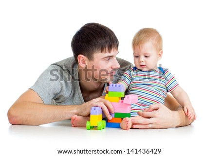 father with his baby son play together - stock photo