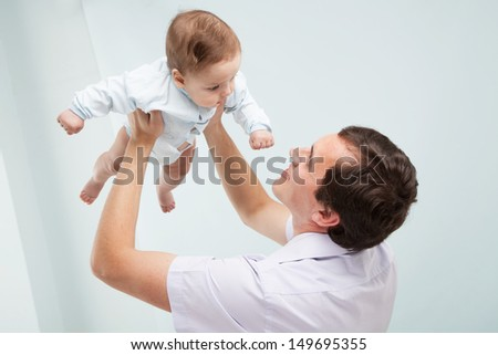 Father with his baby son, studio photo - stock photo