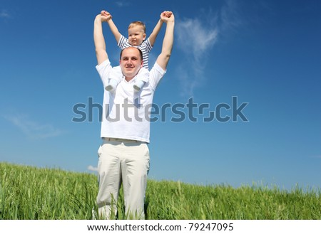 father with his child outdoor against blue sky - stock photo