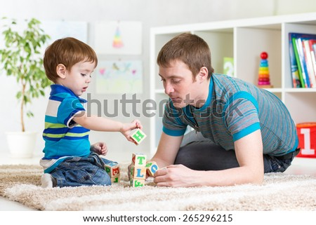 father with his child son playing together
