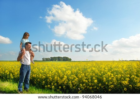 Father with his daughter enjoy the landscape - stock photo