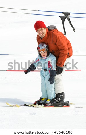 Father with his daughter in the ski lift - stock photo