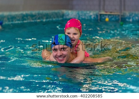 father with his little daughter in the pool
