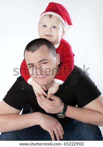 father with his little son sitting pick-a-back in festive uniform