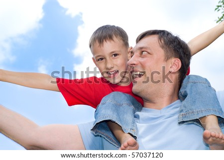 father with his son in a park