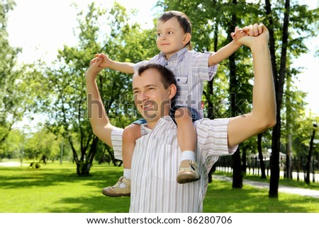 Father with his son in the summer park - stock photo
