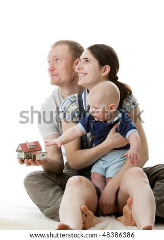 Father with  house  model, mother and  their sweet  baby on a white background. Concept of purchase the house. - stock photo