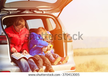 father with kids travel by car in mountains - stock photo