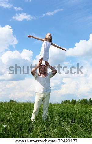 father with little daughter in summer day outdoors - stock photo
