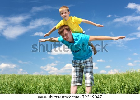 father with little son in summer day outdoors