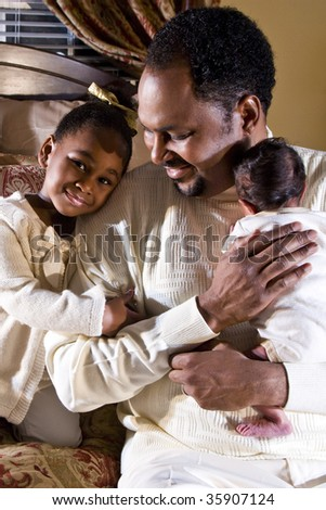 Father with newborn son and four year old daughter - stock photo