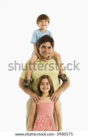 Father with son and daughter standing against white background. - stock photo