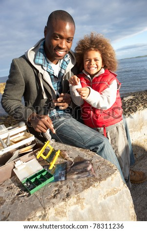 Father with son fishing - stock photo
