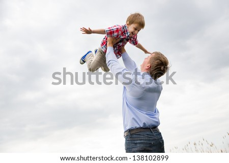 father with son having fun - stock photo