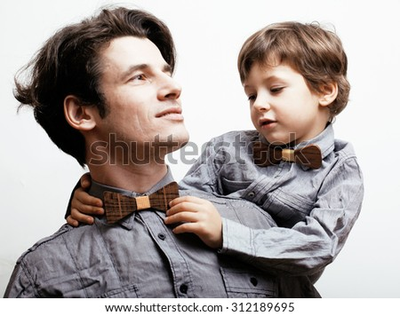 father with son in bowties on white background, casual look modern happy family hipster - stock photo