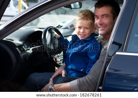 Father with son in car - stock photo