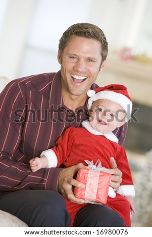 Father With Son In Santa Outfit - stock photo