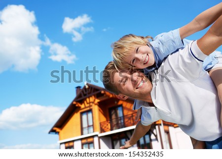 Father with son on the background of sky - stock photo
