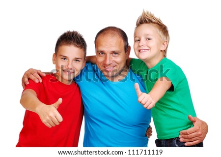 Father with sons showing thumbs up - stock photo
