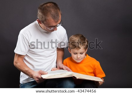 Father with the son read the book