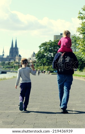 father with two kids - stock photo
