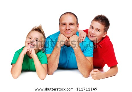 Father with two sons on the floor - stock photo