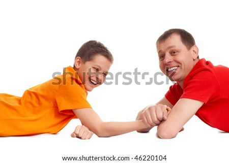 father won son in arm wrestling - stock photo
