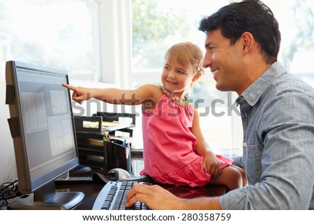 Father working in home office with daughter - stock photo