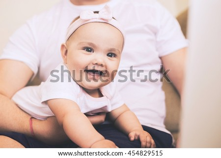 father works at home with the baby. Baby portrait close-up - stock photo