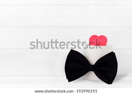 Fathers day / card - love heart with bowtie on light wooden background with space for text  - stock photo