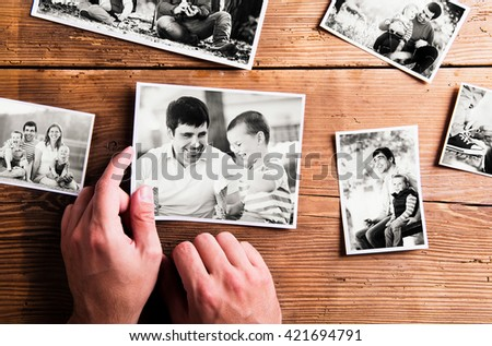 Fathers day composition. Black-and-white pictures, studio shot. Young father is enjoying time with his child. Father and son at home. Handsome father with little boy. Happy fathers day. - stock photo