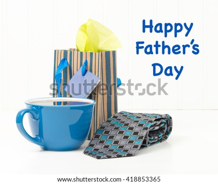 Fathers day gifts of morning coffee and a new tie. - stock photo