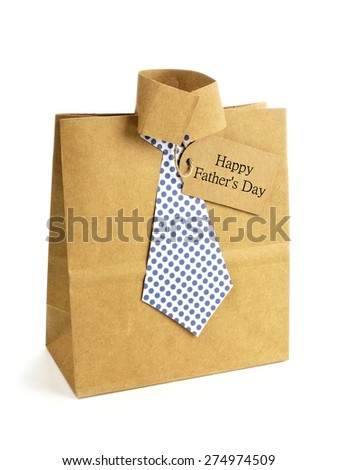 Fathers Day handmade shirt and tie gift bag with greeting card on a white background - stock photo
