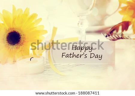 Fathers Day table setting with yellow gerberas - stock photo
