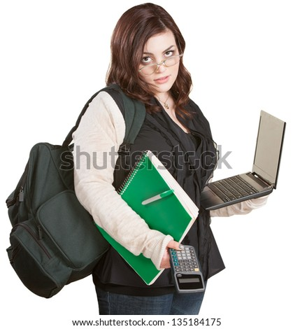 Fatigued student with computer and school supplies - stock photo