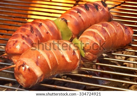 Fatty Sausages On The Hot Barbecue Grill, Tasty Cookout Food - stock photo
