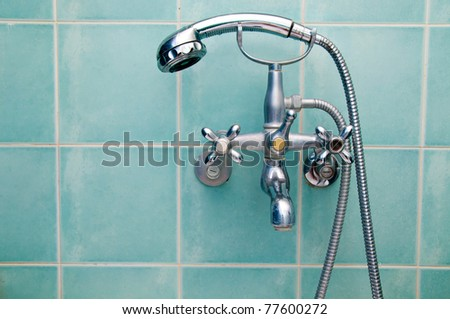 Faucet and shower in bathroom