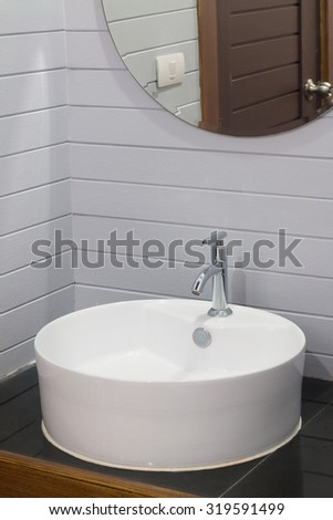 faucet and washbasin on counter-top. - stock photo
