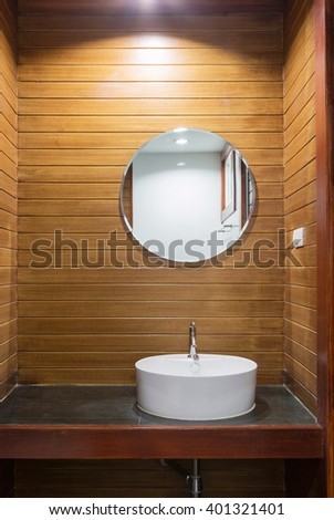 faucet and washbasin on countertop. - stock photo