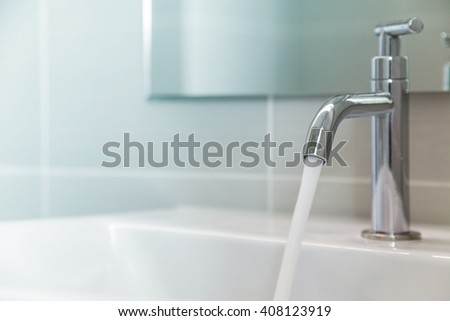 Faucet and water  - stock photo
