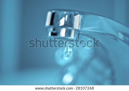 faucet and water drop closeup - stock photo