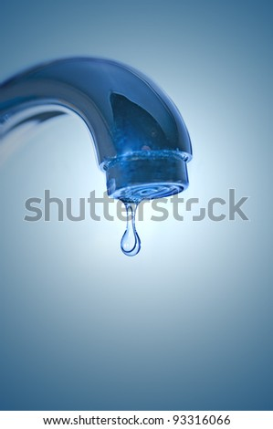 Faucet and water drop closeup - stock photo