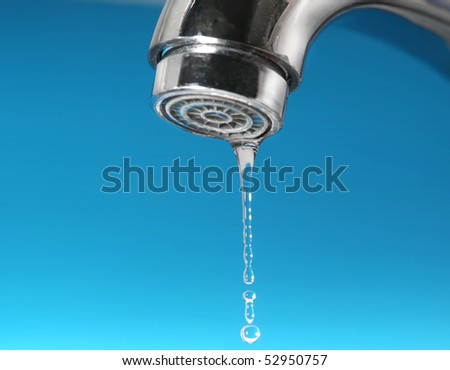 Faucet and water drops - stock photo
