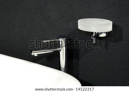 Faucet and white basin over black wall - stock photo