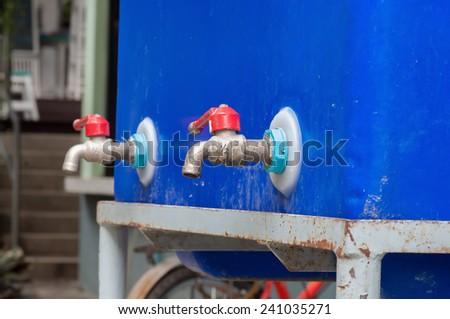 faucet blue tank - stock photo