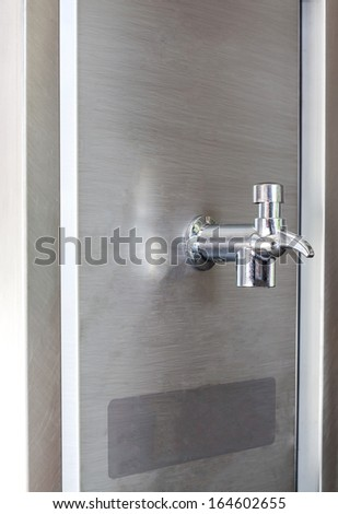Faucet dispenser and water cooler - stock photo