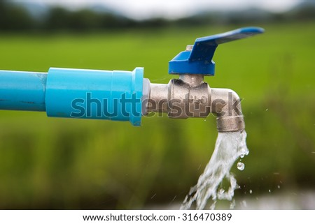 Faucet for watering H2o  Water from faucet  water valve - stock photo