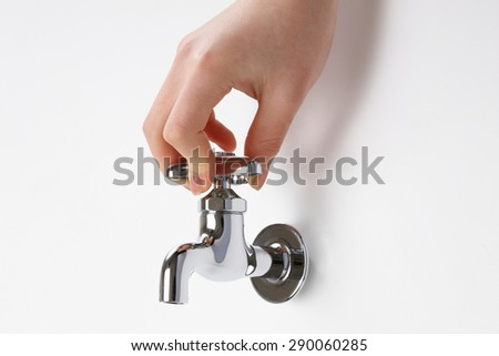 Faucet, hand - stock photo